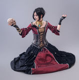 Dark gothic woman. Gothic woman posing with skull stock photography