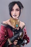 Dark gothic woman. Gothic woman posing in studio stock photo