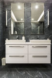 Dark granite bathroom with cabinet Stock Photo