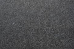 Dark granite. The texture of natural stone slabs for facing the facade of the building. Dark granite. The texture of natural stone slabs for facing the facade stock image