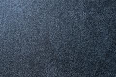 Dark granite. The texture of natural stone slabs for facing the facade of the building.  royalty free stock photos