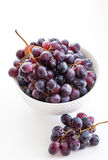 Dark grape in a bowl on white Stock Image