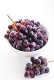 Dark grape in a bowl on white Stock Image