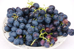 Dark grapes. On a white background Stock Photo