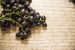 Dark grapes on cork background Stock Photos