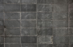 Dark gray block wall background Stock Image