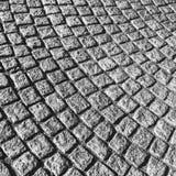 Dark gray cobblestone street pavement Royalty Free Stock Photo