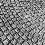 Dark gray cobblestone street pavement Royalty Free Stock Photo