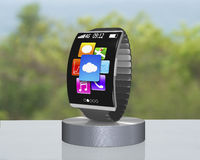 Dark gray curved screen smartwatch on showcase with metal watchb Stock Photography