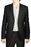 Dark gray evening suit, unfastened blazer, white shirt, no tie. Dark gray wedding suit, unbuttoned jacket, white shirt, no tie, isolated on a white background royalty free stock photo