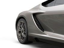 Dark gray modern sports car - rear wheel closeup royalty free stock photography