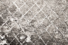Dark gray old concrete wall with notching Royalty Free Stock Photos