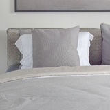 Dark gray pillow with comfy bed in modern bedroom. Dark gray pillow with comfy bed Stock Image