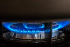 The dark gray pot on gas hob. The dark gray pot on gas flame hob stock photo