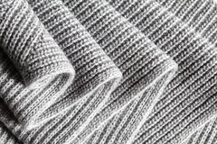 Dark gray ruched knitted wool fabric cool weather background Royalty Free Stock Photography