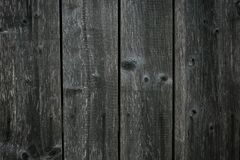 Dark gray shabby boards. Old dark grey fence with hobnail. Antique wooden table. Retro gray wood surface. Old wooden texture backg. Round. Dirty parquet royalty free stock image