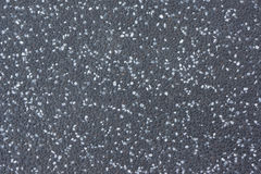 Dark Gray Stone Floor Made of Small Gravels of White, Gray and Black Colors. Aged And Weathered Surface of The Sidewalk Royalty Free Stock Images