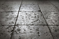 Dark gray stone tiling on the floor, background stock photos