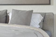 Dark gray and white pillows setting on bed with blanket. Dark gray and white pillows setting on bed with comfy blanket Royalty Free Stock Images