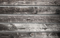 Dark gray wooden wall made of boards, background Royalty Free Stock Photos