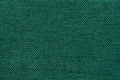 Dark green background of dense woven bagging fabric, closeup. Structure of the textile macro. Royalty Free Stock Image