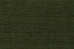 Dark green background of dense woven bagging fabric, closeup. Structure of the textile macro. Stock Photo