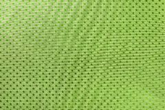 Dark green background from metal foil paper with a stars pattern royalty free stock images