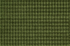 Dark green background from soft fleecy fabric close up. Texture of textiles macro Stock Photo