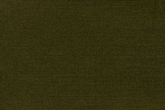 Dark green background from a textile material with wicker pattern, closeup royalty free stock photo