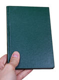 Dark green book in hand Royalty Free Stock Image