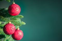 Dark green Christmas background with red balls . royalty free stock images