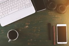 Desktop with laptop and coffee, space for text royalty free stock photos
