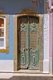 Dark green door in ancient portuguese town of faro Stock Photos