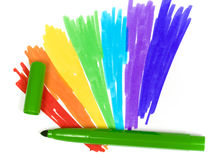 Dark green felt-tip pen with removed cap. On a background of the drawn rainbow royalty free stock photo