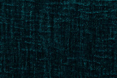 Dark green fluffy background of soft, fleecy cloth. Texture of plush furry textile, closeup. Royalty Free Stock Photo