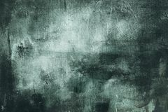 Dark green painting background or texture. Dark green grungy canvas painting, abstract background or texture royalty free stock image