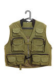 Dark green hunter vest on a hanger Royalty Free Stock Photo