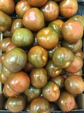 Dark green kumato tomatoes background, Healthy food concept stock images