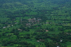 Dark green landscape of a Satara village Stock Image