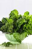 Dark green leafy vegetables in colander Royalty Free Stock Image