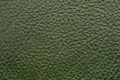 Dark green leather. Furniture upholstery leather of dark green color Stock Photo