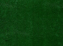 Dark green leather surface. Stock Image