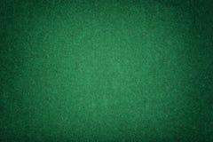 Dark green matt suede fabric closeup. Velvet texture of felt royalty free stock image