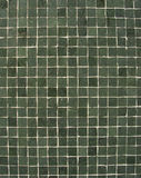 Dark green mosaic pattern on a wall Royalty Free Stock Image