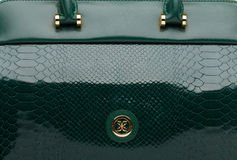 Dark green natural leather female bag closeup Stock Photo