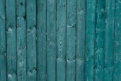 Dark green old wooden boards. Backgrounds and textures fence painted. Front view. Attract beautiful vintage background. Dark green old wooden boards Royalty Free Stock Photography