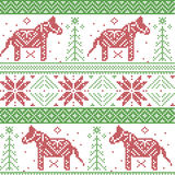 Dark green and red Nordic Christmas pattern with stars, snowflakes, dala style horse in scandinavian style cross stitch Stock Photos