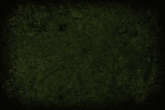 Dark green scratched grunge wall background or texture Stock Photos