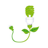 dark green silhouette with spiral fluorescent lamp with leaves and plug Royalty Free Stock Photos