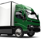 Dark green small box truck - cut shot. Isolated on white background Royalty Free Stock Images